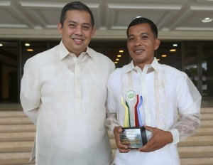 "House Independent Minority Bloc leader and Leyte (1st Dist) Rep.Ferdinand Martin ""FM"" Romualdez (left) congratulates Roger Tilana reporter of DYBR Radio Station in Tacloban City after receiving a Plaque of Appreciation award from the Philippine Drug Enforcement Agency during its 12th Anniversary Celebration in Quezon City.Tilana support the PDEA through his advocacies and initiatives relevant to agencies vision of ""Drug-Free Philippines"".photo by Ver Noveno"