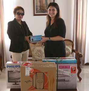 "Yedda Romualdez (right) wife of Leyte (1st Dist) Rep.Ferdinand Martin ""FM"" Romualdez handing over a hi-tech computer with printer to Babatngon Leyte Vice-Mayor Rowena Engle for the computerization of the vice mayor's office.photo by Ver Noveno"