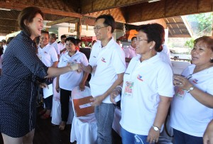 "TRAINING PROGRAM FOR BGY CHIEFS  ------   Yedda Romualdez (right) wife of Leyte (1st Dist) Rep.Ferdinand Martin ""FM"" Romualdez (left) is warmly welcomed by  116 Barangay Chairmen of Tacloban City  during a two day training on "" Katarunganng Pambarangay Law "" held at Papa Kits's Marina & Fishing Lagoon Silot Bay,Liloan Cebu.Romualdez in partnership with the Deparment of Interior and Local Government (DILG) and Department of Labor and Employment (DOLE) sponsored the training program for chairmen to help them handle barangay cases properly.photo by Ver Noveno"