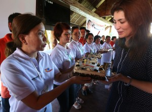 "MRS YEDDA ROMUALDEZ GETS B-DAY GREETINGS FROM BGY CHIEFS -----  Mrs Yedda Romualdez (right) wife of Leyte (1st Dist) Rep.Ferdinand Martin ""FM"" G.Romualdez blows a birthday candle from one of the numerous cakes prepared by Tacloban City Liga ng mga Barangay President Eden Chua-Pineda (left) and other chairwomen at the Papa Kits's Marina & Fishing Lagoon Silot Bay,Liloan Cebu.Mrs Romualdez  in partnership with the Department of Interior and Local Government (DILG) and Department of Labor and Employment (DOLE) sponsored the training program "" Katarungang Pambarangay Law "" for 116 Tacloban City chairmen.The Exercise trained the  barangay chiefs in properly handling cases.photo by Ver Noveno"