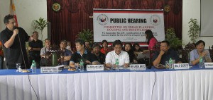"Leyte (1st Dsit) Rep.Ferdinand Martin ""FM"" Romualdez (left) disscusses updates of the Housing and Resettlement for the typhoon Yolanda survivors in his district during the public hearing of Senate Committee on Urban Planning Housing and Resettlement headed by Chairman Sen. JV Ejercito (2nd right) held at University of the Philippines Tacloban Campus.Looking on are from right Sen. Ferdinand Bongbong Marcos Jr.,House Committee Chairman Alfred Benites, and 6th Dist.Quezon City Rep. Jose Christopher Belmonte.photo by Ver Noveno"