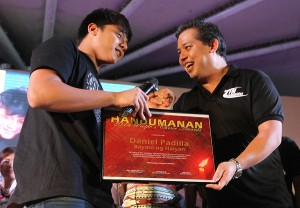 "BAYANI NG YOLANDA ------ Leyte (1st Dist) Rep. Ferdinand Martin ""FM"" Romualdez (right) hand over a plaque of recognition to movie actor Daniel Padilla during the Handumanan 2014 Peoples Choice Awards and Concert at Quezon City Memorial Circle in Quezon City.Padilla held several concerts in typhoon Yolanda (Haiyan)  stricken Tacloban City and other parts of Leyte to give entertainment and  eased traumatic experience by Yolanda survivors.photo by Ver Noveno"
