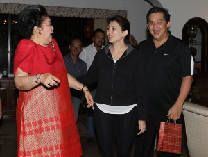 "Former First Lady Imelda Romualdez-Marcos (left)  greets Leyte (1st Dist) Rep. Ferdinand Martin ""FM"" G.Romualdez (right) a happy 51st birthday after singing a mananitas song early Friday morning in Makati City.Also in photo are Cong Romualdez's wife Yedda (2nd right) and Philippine Chamber of Mines President Philip Romualdez (3rd right).photo by Ver Noveno"