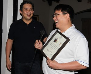 "YOLANDA HEROES ---- Cornell Club of the Philippines President and Leyte (1st Dist) Rep. Ferdinand Martin ""FM"" G. Romualdez (left) awards a plaque of recognition to John Antonio Dionisio - of Upsilon Sigma Phi Fraternity for sending more than 30 members who are doctors and nurses  to conducted medical missions in diffrent parts of Leyte for the suvivors of super typhoon Yolanda.The awarding was held during the annual festivities  of the Cornell Club of the Philippines in Makati City.photo by Ver Noveno"