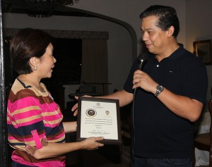 """YOLANDA HEROES ---- Cornell Club of the Philippines President and Leyte (1st Dist) Rep. Ferdinand Martin """"FM"""" G. Romualdez (right) awards a plaque of recognition to former Marikina Mayor Marides Ferdinando (left) and  husband former MMDA Chairman Bayani Fernando (not in photo) for sending  heavy equipments and trucks to clear debris of super typhoon Yolanda in Tacloban City and other parts of Leyte.The awarding was held during the annual festivities of the Cornell Club of the Philippines in Makati City.photo by Ver Noveno"""