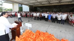 """Independent Minority Bloc leader and Leyte (1st Dist) Rep.Ferdinand Martin """"FM"""" G. Romualdez (left) delivers his message of gratitude to the members of Congress and employees for assisting his constituents in overcoming their trauma from the tragedy.Cong Romualdez is the guest of honor and speaker during the Flag Ceremony hosted by the Legal Affairs Department of the House of Representatives.photo by Ver Noveno"""