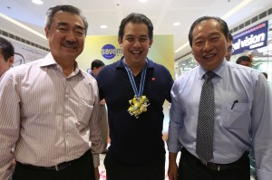 "Leyte (1st Dist) Rep. Ferdinand Martin ""FM"" Romualdez (center) with SM Prime Holdings Inc.President Hans Sy (left) and SM Food Retail Vice Chairman Herbert Sy (right) shares a light moment inside the new SM Save More Department store during the opening in Downtown Tacloban City.photo by Ver Noveno"