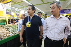 "Leyte (1st Dist) Rep. Ferdinand Martin ""FM"" Romualdez (center) with SM Prime Holdings Inc.President Hans Sy (right) and SM Food Retail Vice Chairman Herbert Sy (left) walk tours inside the new SM Save More Department store during the opening in Downtown Tacloban City.photo by Ver Noveno"