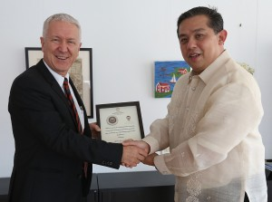 "YOLANDA HEROES -----   Leyte (1st Dist) Rep.Ferdinand Martin ""FM"" Romuadez (right) hand over a plaque of recognition to Switzerland Ambassador to the Philippines Ivo Sieber (left) for helping the victims of super typhoon Yolanda in Leyte.during their meeting at the Swiss Embassy in Paseo De Roxas St. Makati City.photo by Ver Noveno"