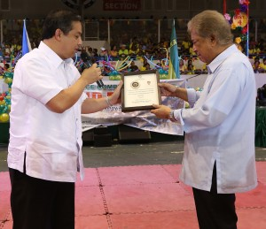 "ROMUALDEZ THANKS BAGATSING FOR BEING YOLANDA HERO -----  Leyte (1st Dist) Rep.Ferdinand Martin ""FM"" Romualdez (left) hand over a plaque of recognition to 5th District of Manila Rep.Amado Bagatsing (right) during the 29th Anniversary of Kabaka  and Cheer Dance Competition at the Ninoy Aquino Stadium in Malate Manila. Bagatsing immediately sent numerous trucks loaded with relief goods to Yolanda victims in Tacloban City and Palo Leyte .photo by Ver Noveno"