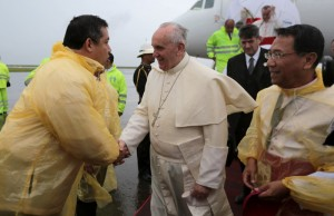 "Leyte (1st Dist) Rep.Ferdinand Martin ""FM"" Romualdez (left) warmly welcome Pope Francis upon arrival at Daniel Z. Romualdez Airport in Tacloban City Saturday.Looking on is Palo Archbishop John Du (right).photo by Ver Noveno"