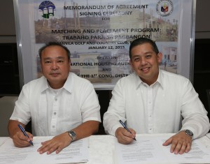 "Leyte (1st Dist) Rep. Ferdinand Martin ""FM"" Romualdez (right) and National Housing Authority General Manager Atty.Chito Cruz (left) inked a memorandum of Agreement for ""Matching and Placement Program: Trabahao para sa Pagbangon"" for the development of resettlement sites in various areas in Tacloban City and some parts of the Leyte Province.The Memorandum of Agreement Signing Ceremony was held at the Manila Golf and Country Club in Makati City.Photo by Ver Noveno"