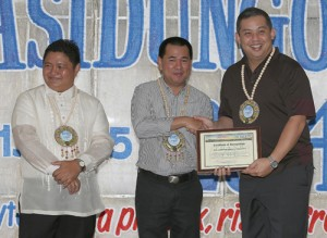 "Leyte (1st Dist) Rep.Ferdinand Martin ""FM"" Romualdez (right) received a plaque of recognition from Leyte Governor Dominic Petilla (center) during the Department of Education Pasidungog 2014 at Palo Leyte.Romualdez was awarded by DepEd for his magnanimous assistance to the Department of Education Division of Leyte in the rehabilitation,repair and reconstruction of school buildings,facilities and amenities in the aftermath of super typhoon Yolanda.Looking on is Dep Ed School Division Superintendent Ronelo Al Firmo (left).photo by Ver Noveno"